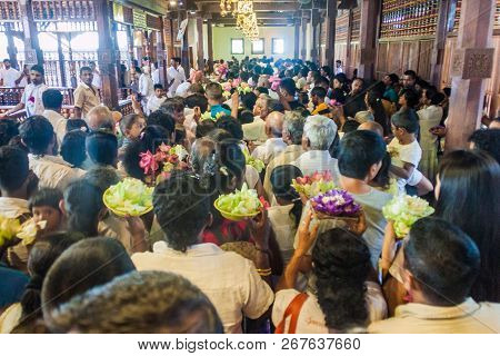 Kandy, Sri Lanka - July 19, 2016: White Clothed Buddhist Devotees In The Temple Of Sacred Tooth Reli