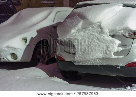 Cars Are Covered With Snow After Night Of Snowfall. Snow Storm Covered Cars With Thick Layer Of Snow