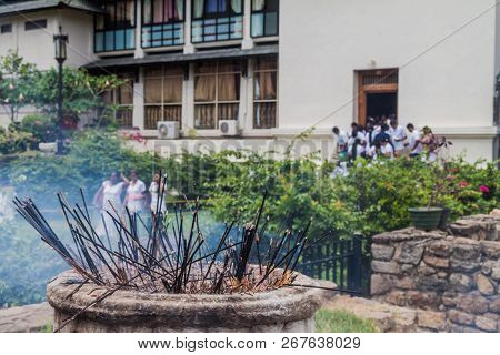 Incense Sticks Burn At The Grounds Of The Temple Of Sacred Tooth Relic During Poya Full Moon Holiday