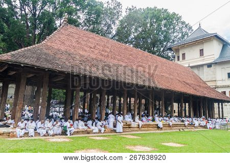 Kandy, Sri Lanka - July 19, 2016: White Clothed Buddhist Devotees Eat At The Grounds Of The Temple O