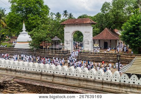 Kandy, Sri Lanka - July 19, 2016: White Clothed Buddhist Devotees At The Grounds Of The Temple Of Sa