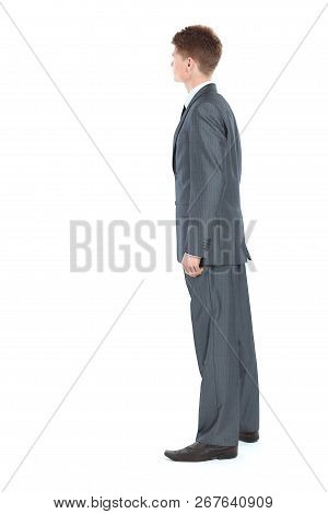 Side View.confident Businessman In Full Growth. Isolated On A White Background.
