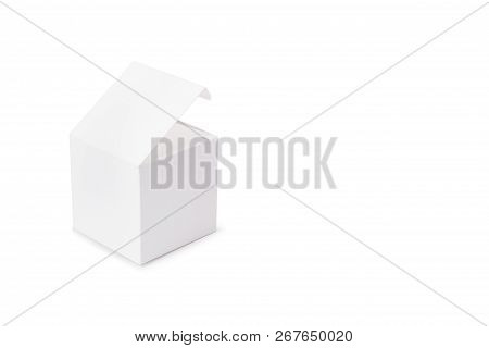 A White Cardboard Box On A White Background On The Left. Box Mock-up. Photo Of Square White Box. Sid