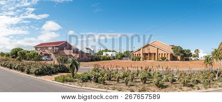 Yzerfontein, South Africa, August 20, 2018: A Panoramic Street Scene, With A House And The Dutch Ref