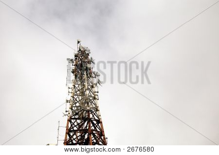 Low Shot Of Communications Tower Against Cloudy Skies