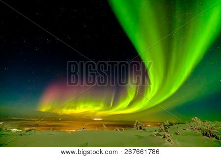 Aurora Borealis (also Known Like Northern Or Polar Lights) Beyond The Arctic Circle In Winter Laplan
