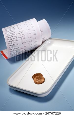 Reciept and tray isolated on blue background.