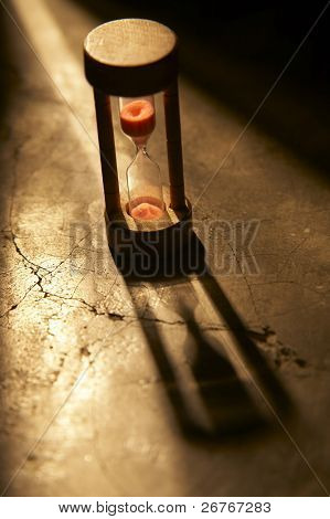 Stock image of hourglass isolated on the background.