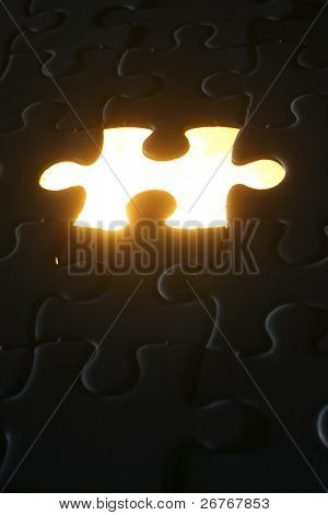 Light shining out of a missing puzzle piece.