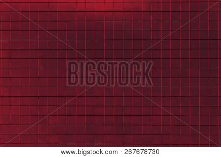 Close-up Of A Red Colored Tiled Wall. View To A Purple Colored Metallic Wall. Geometric Shapes And B