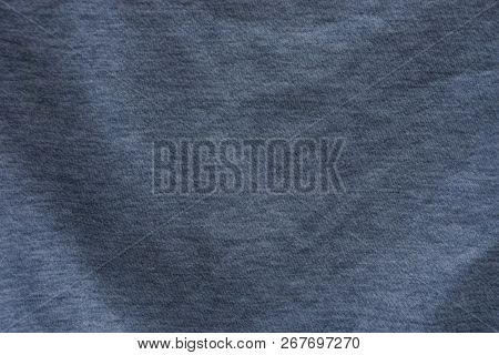 Gray Background Fabric Of Crumpled Matter On The Part Of Old Clothes