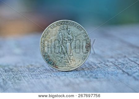 Big Old Soviet Ruble Is Standing On A Gray Table