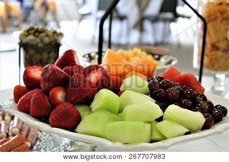 Fresh Fruit Piled On A White Platter.