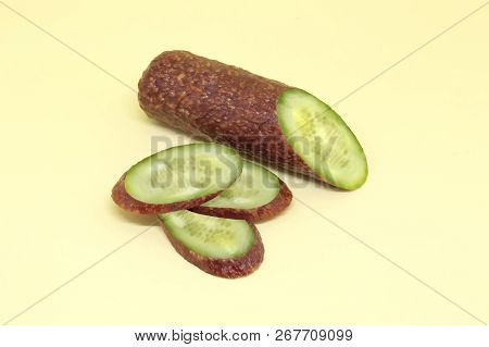 Piece And Slices Of Saveloy With Cucumber Inside. Unexpected Food Concept. Joke For Vegans And Meat