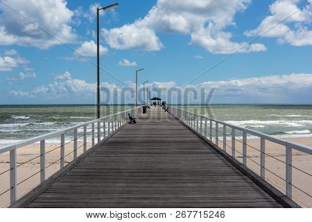 The Grange Jetty With A Blue Sky And White Fluffy Clouds At Grange South Australia On 7th November 2