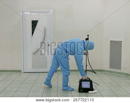 Inspector are testing dust inside the operating room with Particle Counter. poster