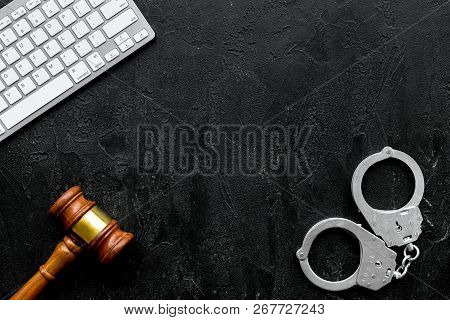 Arrest Of A Hacker For Cyber Fraud Concept. Handcuff Near Keyboard And Judge Gavel On Black Backgrou