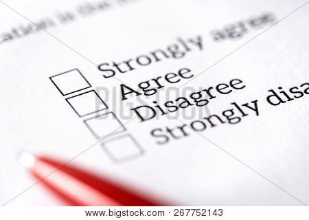 Opinion Poll, Survey And Questionnaire Concept. Filling Multiple Choice Question Form With Paper And