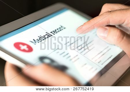Electronic Medical Record With Patient Data And Health Care Information In Tablet. Doctor Using Digi
