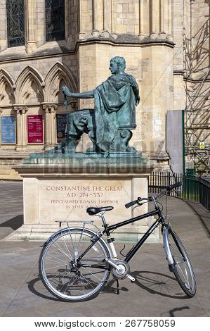 York, England - April 2018: A Bicycle At Statue Of Constantine The Great Situated Outside York Minst