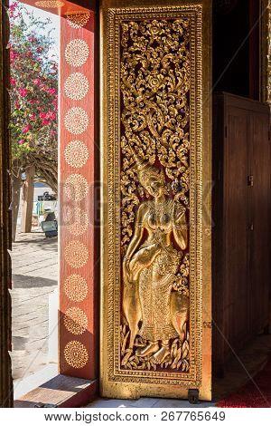 Religious Carvings On The Doors Of Wat Xieng Thong, Luang Prabang, Laos