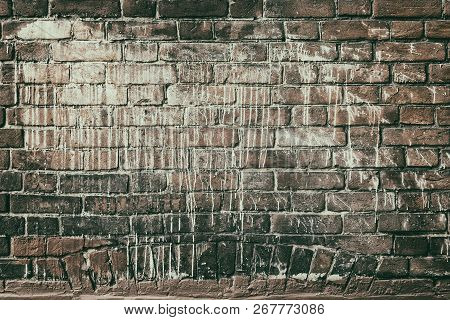 Old Red Brick Wall Drenched In White Paint. Faded Retro Grunge Background