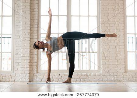 Young Sporty Yogi Woman Practicing Yoga, Doing Half Moon Exercis