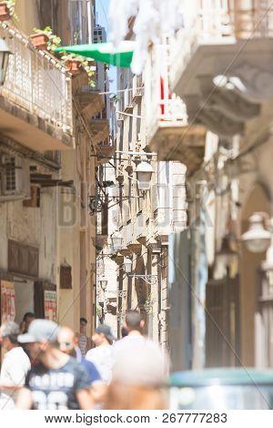 Taranto, Apulia, Italy - May 31, 2017 - Tourists Walking Through The Small Alleyways Of Taranto