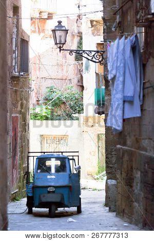 Taranto, Apulia, Italy - May 31, 2017 - An Old Three Wheeler Car In An Allyway Of Taranto