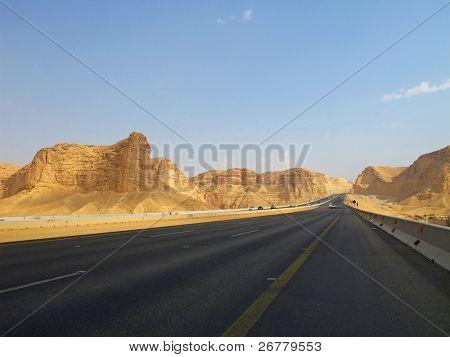 Road trough the desert Riyadh-Makkah(Mecca) highway in Saudi Arabia poster