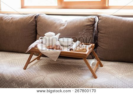 Cozy Breakfast. Wooden Serving Tray With Teapot, Mug Of Steamy Hot Beverages In Home Interior. Food,