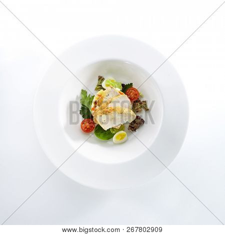Salad with Chicken and Homemade Mayonnaise Isolated on White Background. Exquisite Serving Olivier Salat with Sliced Poultry Meat, Quail Eggs and Greens Top View poster