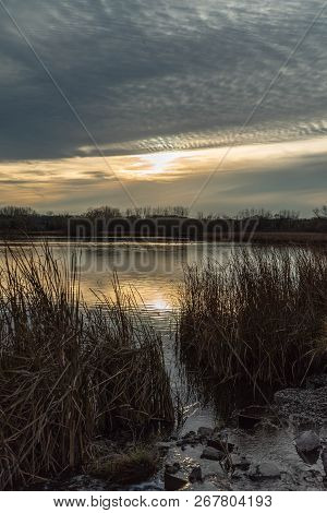 Gorgeous Sunset Reflecting Over A Lake In A Marshland