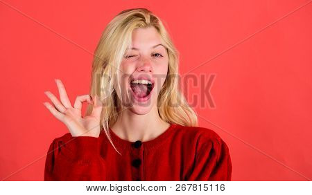 Things Gonna Be Alright. Girl Wink Happy Face While Show Ok Gesture Over Red Background. Woman Satis