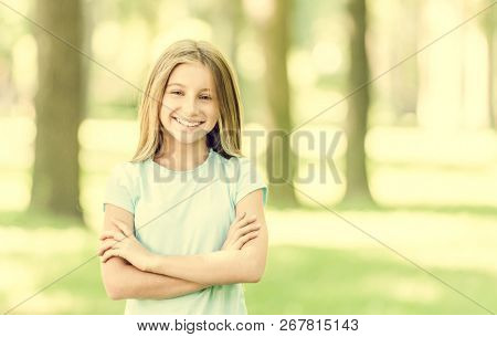 cute teen girl smiling in the morning park. blurred background