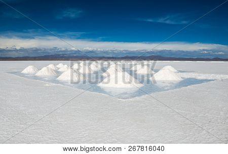 Sunshine scenery of area with salt banks in Salar de Uyuni in Bolivia
