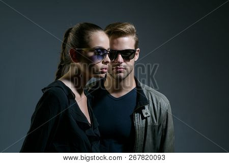 An Intellectual Look. Fashion Models In Trendy Sun Glasses. Couple In Love. Couple Of Man And Woman