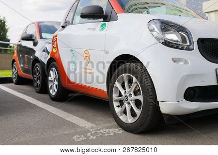 MOSCOW - JUN 22, 2018: White and black Mercedes Smart cars of Moscow carsharing company You drive are on parking, carsharing is system of short-term car rental