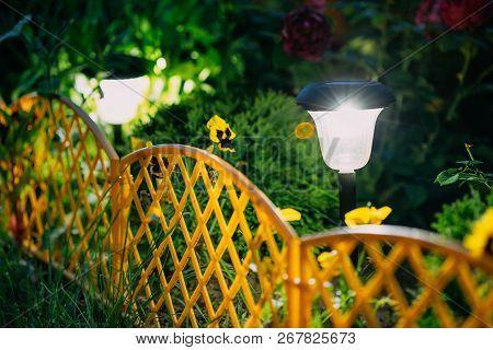 Solar Garden Light, Small Decorative Lanterns In Flower-bed. Garden Design. Solar Powered Lamp.