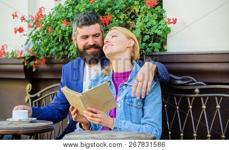 Man With Beard And Blonde Woman Cuddle On Romantic Date. Romance Concept. Couple Flirting Romantic D