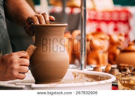 Process Of Creating A Clay Pot. Using Hands. Pottery Craft Wheel And Ceramic Clay Pot. Traditional N