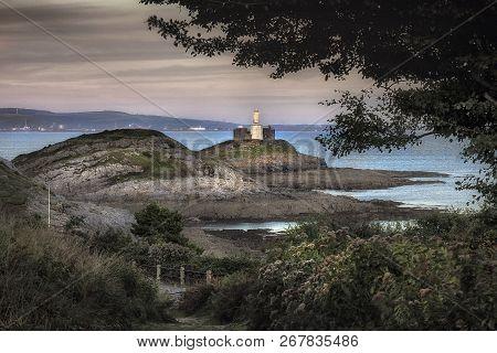 Mumbles Lighthouse Swansea Bay The Iconic Structure In Swansea Bay, Uk, The Mumbles Lighthouse With