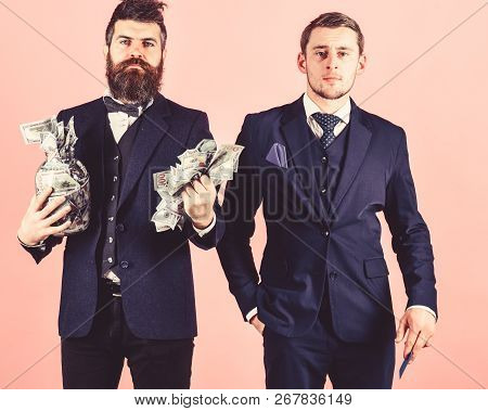 Men In Suit, Businessmen With Jar Full Of Cash And Credit Card, Pink Background. Mature Man Wants To