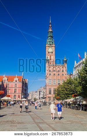 Gdansk, Poland -  September 1, 2016: People Walk Along Historic Houses At Dlugi Targ Square In Gdans