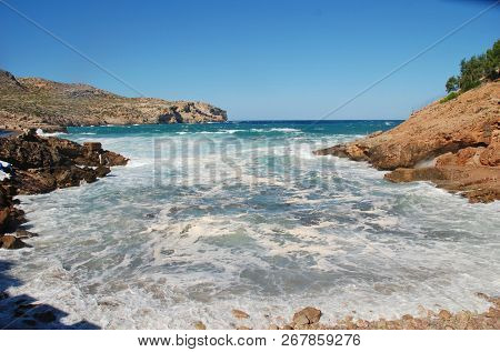 Stormy seas break on Cala Carbo beach at Cala San Vicente on the Spanish island of Majorca.