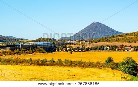 Typical Cone Hill Of Milesovka Mountain. Landscape Of Ceske Stredohori, Central Bohemian Highlands,