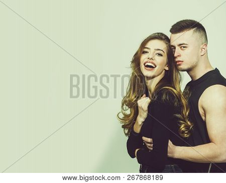 Young Couple Of Pretty Woman Or Cute Sexy Girl With Long Beautiful Curly Blonde Hair And Red Lips On