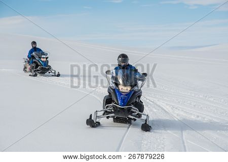 Vatnajokull Iceland - September 22. 2018: Tourists Riding A Snowmobile At Vatnajokull Glacier