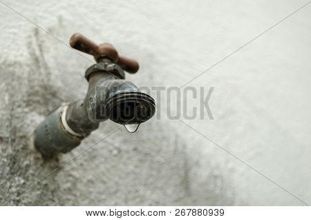 Faucet Dripping Water, Concept Of Water Shortage, Lack Of Water, Close Up To A Drop Of Water Falling