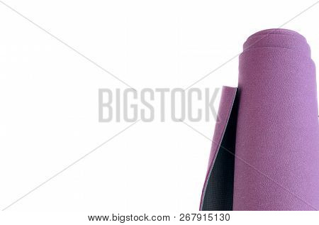 Yoga Rolled Exercise Mat On White Wooden Background With Copy Space. Concept For Ashtanga Yoga Pract